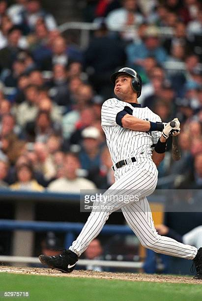 Derek Jeter of the New York Yankees swings at a pitch during Game two of the 1996 American League Championship Series against the Baltimore Orioles...