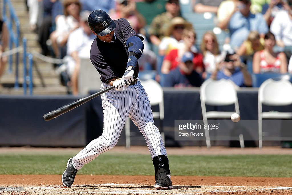 Derek Jeter #2 of the New York Yankees swings at a pitch in the first inning of a game against the Boston Red Sox at George M. Steinbrenner Field on March 18, 2014 in Tampa, Florida.