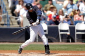 Derek Jeter of the New York Yankees swings at a pitch in the first inning of a game against the Boston Red Sox at George M Steinbrenner Field on...