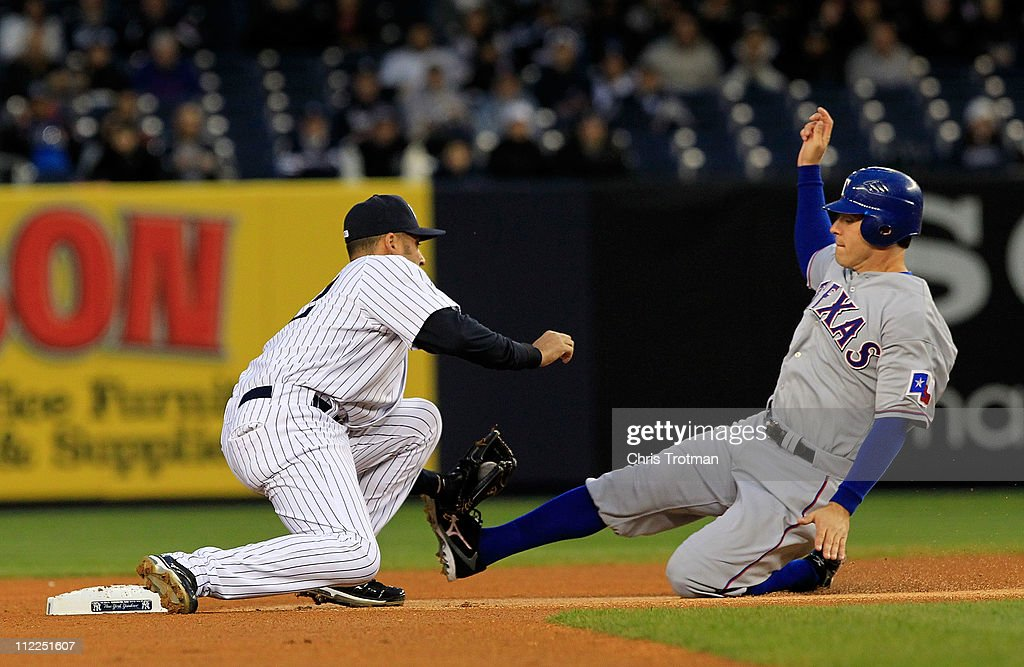 Derek Jeter of the New York Yankees tags out Ian Kinsler of the Texas Rangers at Yankee Stadium on April 15 2011 in the Bronx borough of New York City