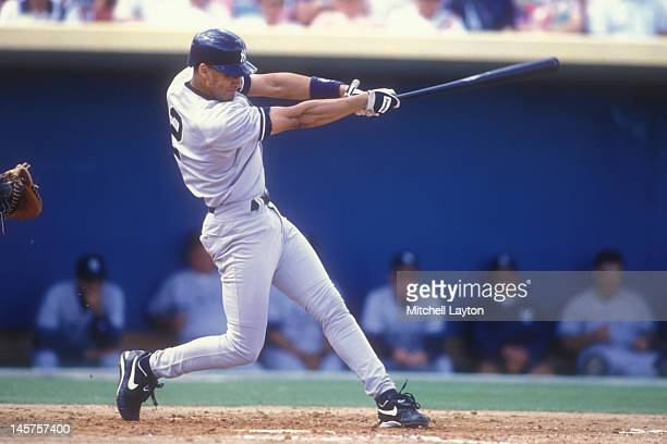 Derek Jeter of the New York Yankees takes a swing during a spring training baseball game against the Pittsburgh Pirates on March 2 1996 at McKenchie...