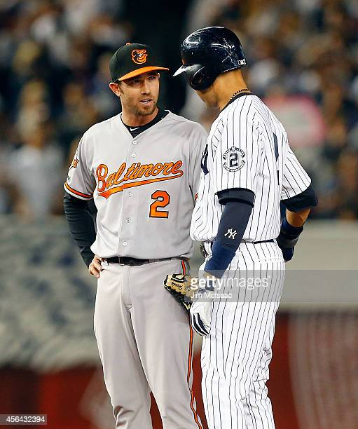 Derek Jeter of the New York Yankees talks with JJ Hardy of the Baltimore Orioles during the first inning at Yankee Stadium on Thursday September 25...