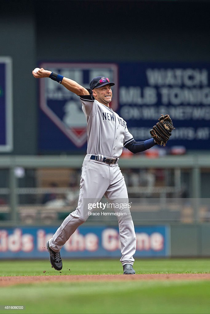 <a gi-track='captionPersonalityLinkClicked' href=/galleries/search?phrase=Derek+Jeter&family=editorial&specificpeople=167125 ng-click='$event.stopPropagation()'>Derek Jeter</a> #2 of the New York Yankees throws against the Minnesota Twins on July 5, 2014 at Target Field in Minneapolis, Minnesota. The Twins defeated the Yankees 2-1.