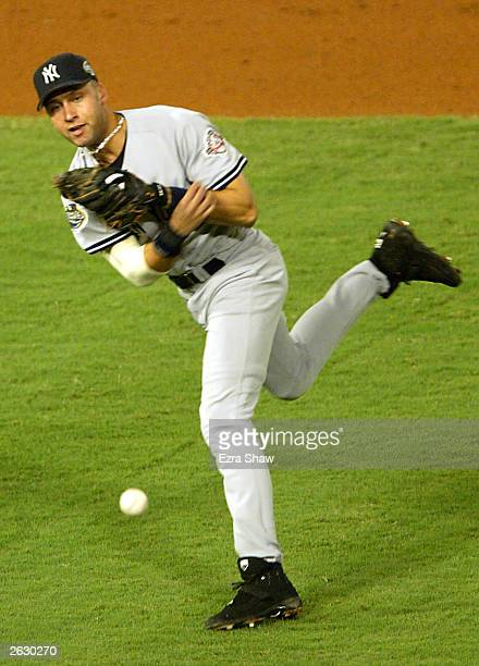 Derek Jeter of the New York Yankees throws out Ivan Rodriguez of the Florida Marlins in the third inning during game four of the Major League...