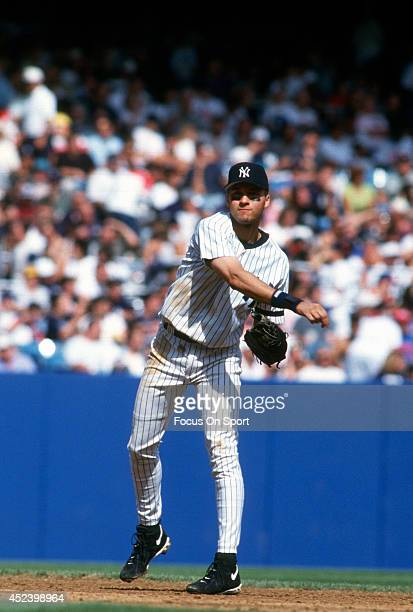 Derek Jeter of the New York Yankees throws the ball to first base during an Major League Baseball game circa 1996 at Yankee Stadium in the Bronx...