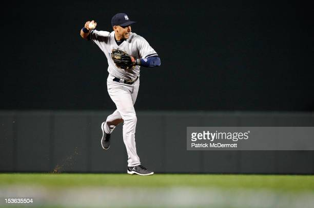 Derek Jeter of the New York Yankees throws the ball to first base to force out Adam Jones of the Baltimore Orioles in the bottom of the first inning...