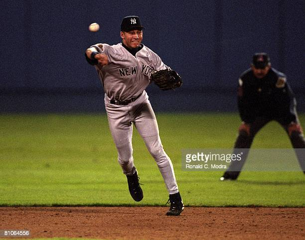 Derek Jeter of the New York Yankees throws to first base during the 1996 World Series against the Atlanta Braves on October 24 1996 in Atlanta Georgia