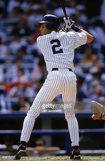 Derek Jeter of the New York Yankees waits for the pitch during the game against the Boston Red Sox at Yankee Stadium on September 21 1996 in Bronx...