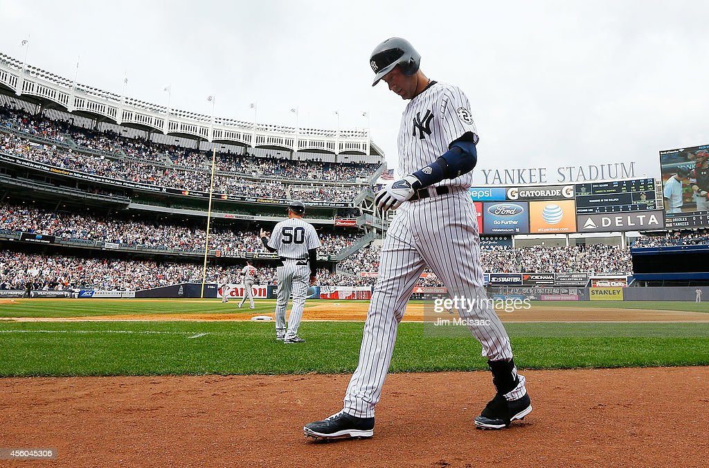 <a gi-track='captionPersonalityLinkClicked' href=/galleries/search?phrase=Derek+Jeter&family=editorial&specificpeople=167125 ng-click='$event.stopPropagation()'>Derek Jeter</a> #2 of the New York Yankees walks back to the dugout after grounding out in the eighth inning against the Baltimore Orioles at Yankee Stadium on September 24, 2014 in the Bronx borough of New York City.