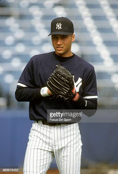 Derek Jeter of the New York Yankees warms up during batting practice prior to the start of a Major League Baseball game circa 1996 at Yankee Stadium...
