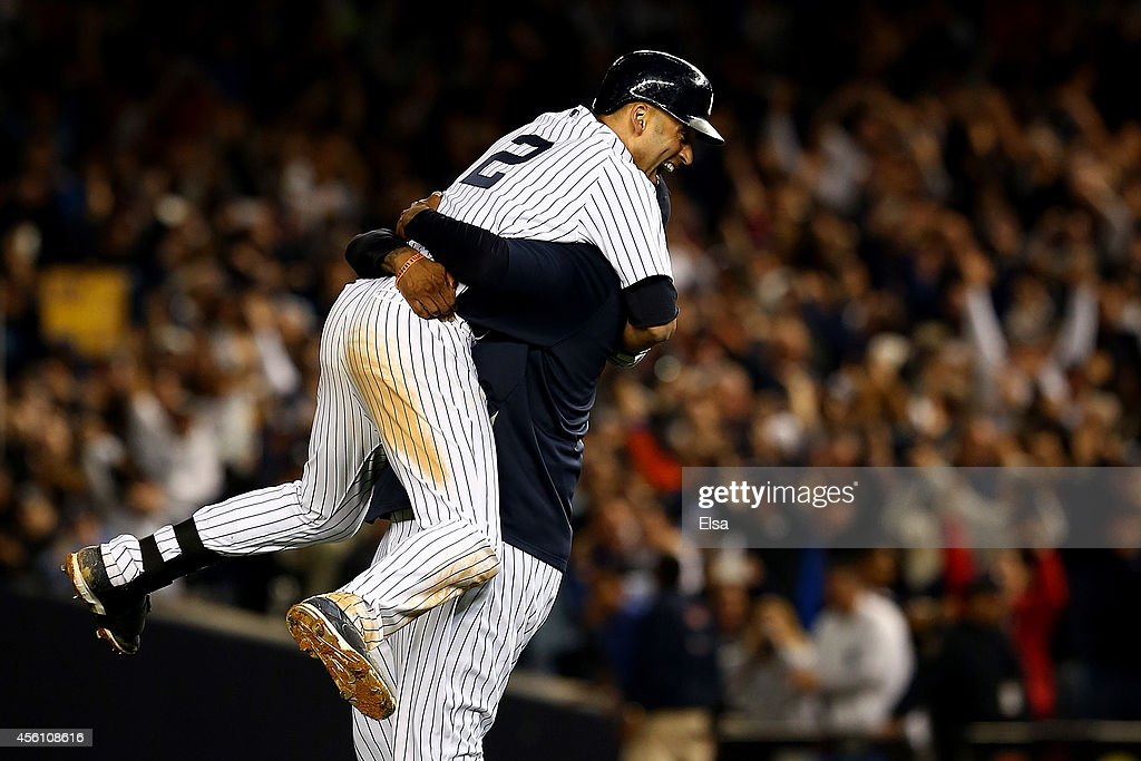 Derek Jeter #2 of the New York Yankees with CC Sabathia #52 after a game winning RBI hit in the ninth inning against the Baltimore Orioles in his last game ever at Yankee Stadium on September 25, 2014 in the Bronx borough of New York City.