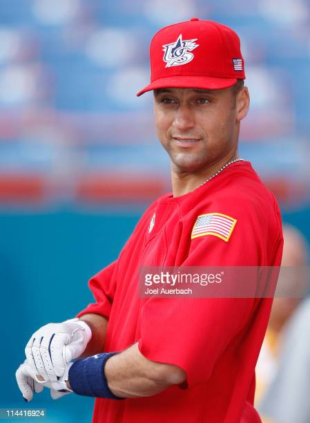 Derek Jeter of the USA waits his turn at the batting cage during a practice session for the World Baseball Classic at Dolphin Stadium on March 13...