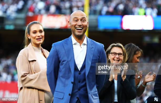 Derek Jeter reacts with his family looking on during the retirement ceremony of his number 2 jersey at Yankee Stadium on May 14 2017 in New York City