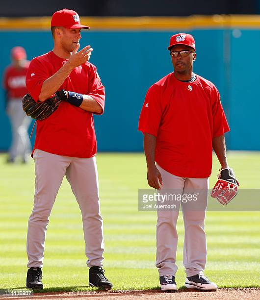 Derek Jeter talks to Jimmy Rollins of the USA during the team practice for the World Baseball Classic at Dolphin Stadium on March 13 2009 in Miami...