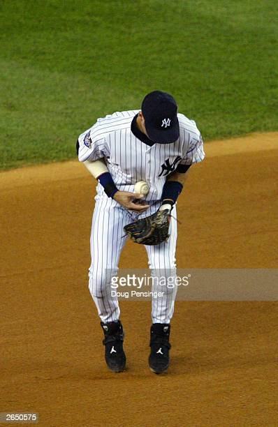 Derek Jeter the New York Yankees bobbles the ball and commites an error on the Jeff Conine of the Florida Marlins grounder in the sixth inning during...