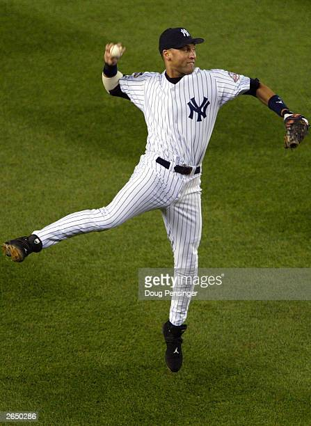 Derek Jeter the New York Yankees throws to first to force out Mike Lowell of the Florida Marlins in the fourth inning during game six of the Major...