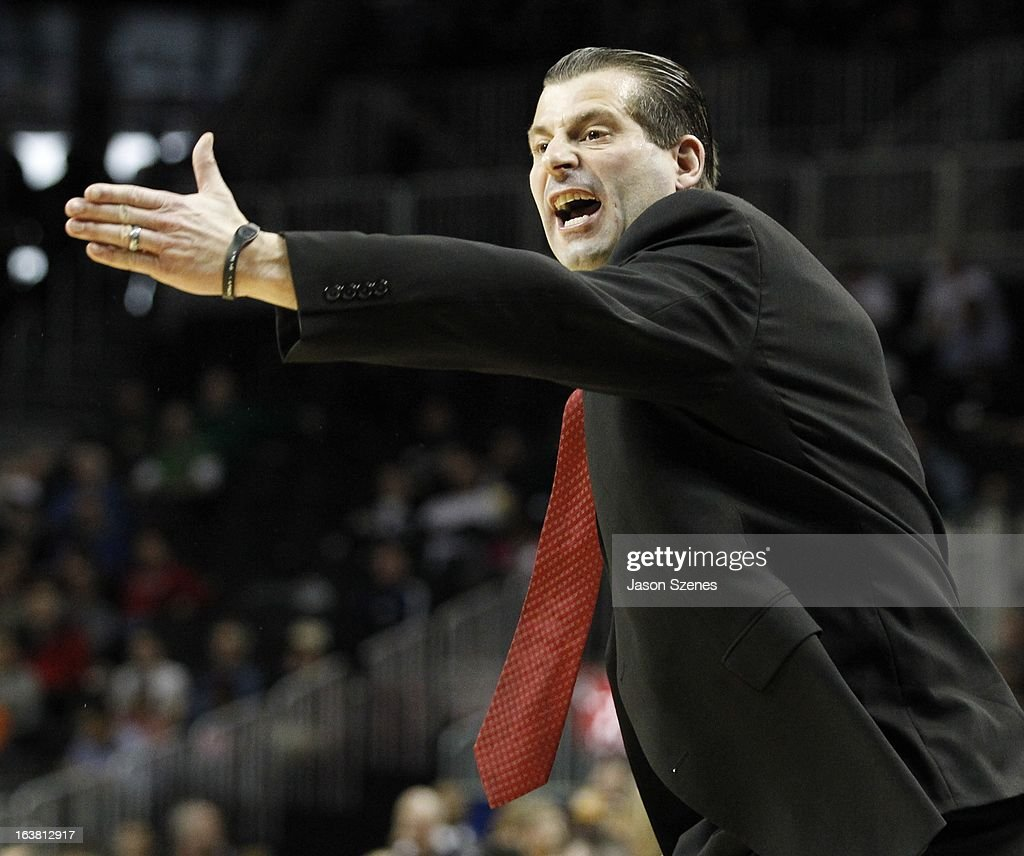 Derek Kellogg, head coach of the Massachusetts Minutemen, reacts during his teams game against the Virginia Commonweath Rams during the first half during the Atlantic 10 Basketball Tournament - Semifinals at the Barclays Center on March 16, 2013 in the Brooklyn borough of New York City.