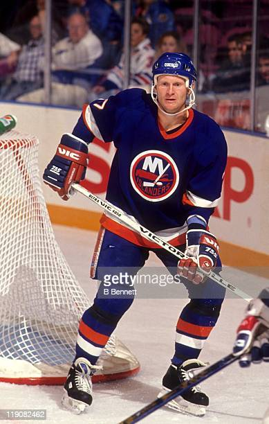 Derek King of the New York Islanders skates around the net during an NHL game against the New York Rangers circa 1989 at the Madison Square Garden in...