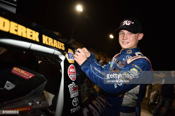 Derek Kraus driver of the Carlyle Tools Toyota places the winner's decal on his car after winning the NASCAR KN Pro Series West Coast Stock Car Hall...