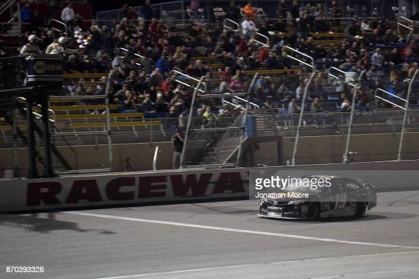 Derek Kraus driver of the Carlyle Tools Toyota takes the checkered flag during the NASCAR KN Pro Series West Coast Stock Car Hall of Fame...