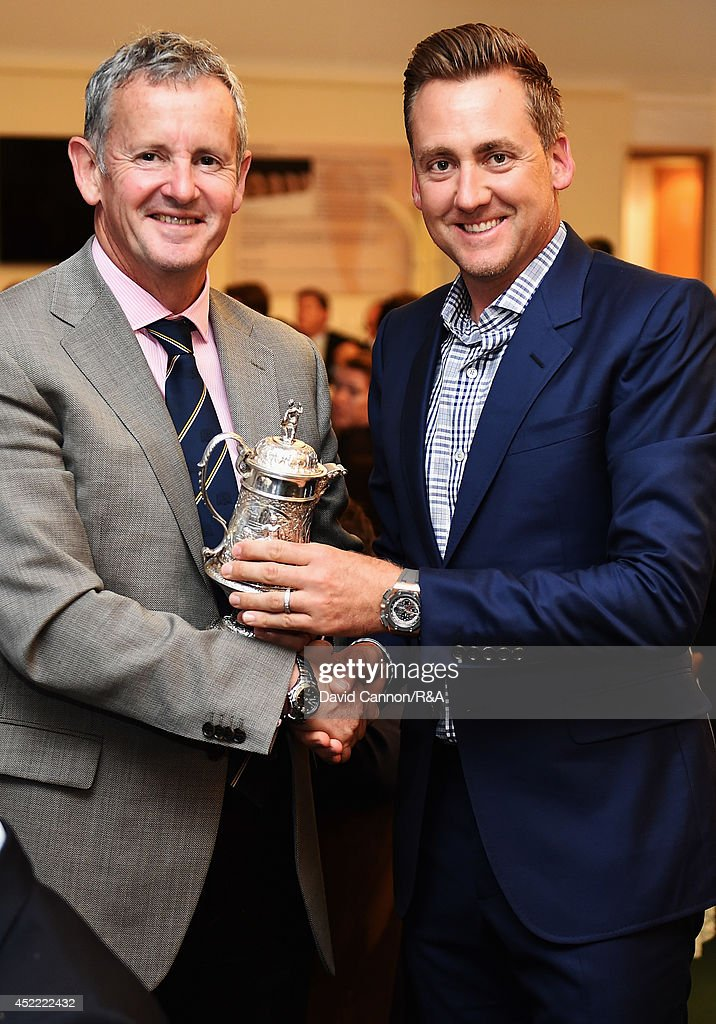 Derek Lawrenson, Chairman of the Association of Golf Writers, presents <a gi-track='captionPersonalityLinkClicked' href=/galleries/search?phrase=Ian+Poulter&family=editorial&specificpeople=171444 ng-click='$event.stopPropagation()'>Ian Poulter</a> of England with the AGW Open Award for Media Relations during the AGW annual dinner prior to the start of the 143rd Open Championship at Royal Liverpool on July 15, 2014 in Hoylake, England.