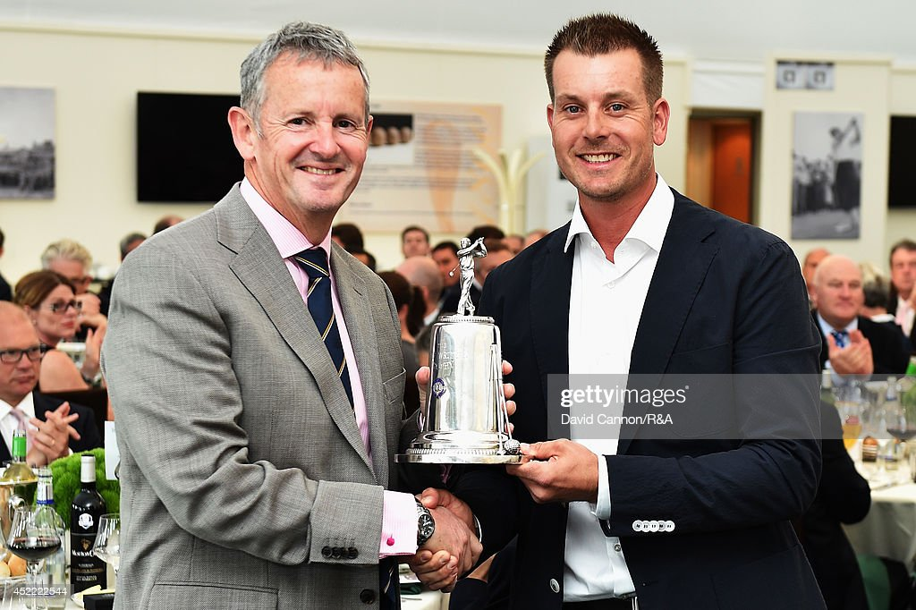 Derek Lawrenson, Chairman of the Association of Golf Writers, presents <a gi-track='captionPersonalityLinkClicked' href=/galleries/search?phrase=Henrik+Stenson&family=editorial&specificpeople=211537 ng-click='$event.stopPropagation()'>Henrik Stenson</a> of Sweden with the AGW Player of the Year Award during the AGW annual dinner prior to the start of the 143rd Open Championship at Royal Liverpool on July 15, 2014 in Hoylake, England.