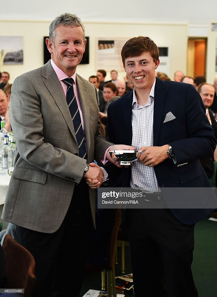 Derek Lawrenson, Chairman of the the Association of Golf Writers, presents <a gi-track='captionPersonalityLinkClicked' href=/galleries/search?phrase=Matthew+Fitzpatrick+-+Golfer&family=editorial&specificpeople=8019521 ng-click='$event.stopPropagation()'>Matthew Fitzpatrick</a> of England with the AGW Young Golfer of the Year award during the AGW annual dinner prior to the start of the 143rd Open Championship at Royal Liverpool on July 15, 2014 in Hoylake, England.