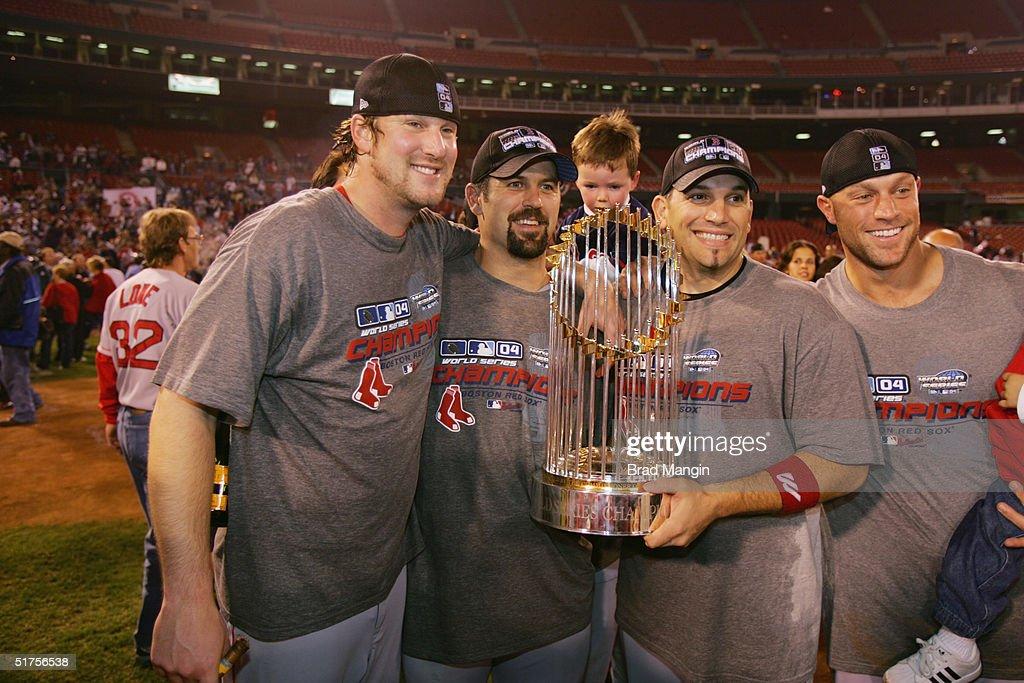 Derek Lowe Jason Varitek Doug Mirabelli and Gabe Kapler of the Boston Red Sox celebrate after winning game four of the 2004 World Series against the...