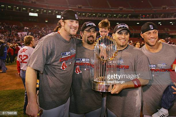 Derek Lowe Jason Varitek Doug Mirabelli and Gabe Kapler of the Boston Red Sox celebrate after winning game four of the 2004 World Series against the...
