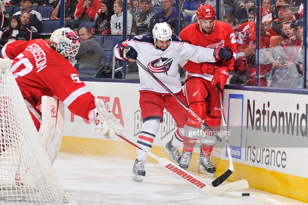 <a gi-track='captionPersonalityLinkClicked' href=/galleries/search?phrase=Derek+MacKenzie&family=editorial&specificpeople=685877 ng-click='$event.stopPropagation()'>Derek MacKenzie</a> #24 of the Columbus Blue Jackets and Brian Lashoff #23 of the Detroit Red Wings battle for possession of the puck during the third period on March 9, 2013 at Nationwide Arena in Columbus, Ohio. Columbus defeated Detroit 3-0.