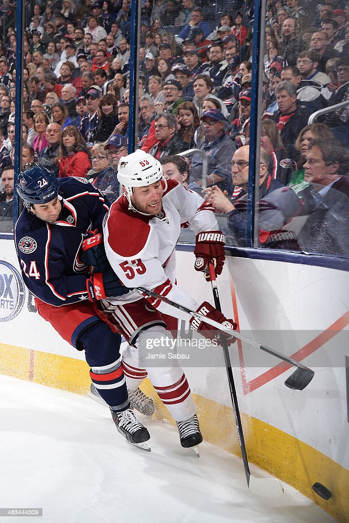 <a gi-track='captionPersonalityLinkClicked' href=/galleries/search?phrase=Derek+MacKenzie&family=editorial&specificpeople=685877 ng-click='$event.stopPropagation()'>Derek MacKenzie</a> #24 of the Columbus Blue Jackets and <a gi-track='captionPersonalityLinkClicked' href=/galleries/search?phrase=Derek+Morris&family=editorial&specificpeople=204188 ng-click='$event.stopPropagation()'>Derek Morris</a> #53 of the Phoenix Coyotes battle as they skate after a loose puck during the third period on April 8, 2014 at Nationwide Arena in Columbus, Ohio. Columbus defeated Phoenix 4-3 in overtime.