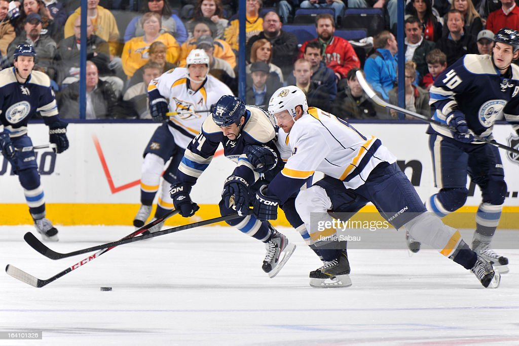 <a gi-track='captionPersonalityLinkClicked' href=/galleries/search?phrase=Derek+MacKenzie&family=editorial&specificpeople=685877 ng-click='$event.stopPropagation()'>Derek MacKenzie</a> #24 of the Columbus Blue Jackets and Kevin Klein #8 of the Nashville Predators battle for possession of the puck during the third period on March 19, 2013 at Nationwide Arena in Columbus, Ohio. Columbus defeated Nashville 4-3.