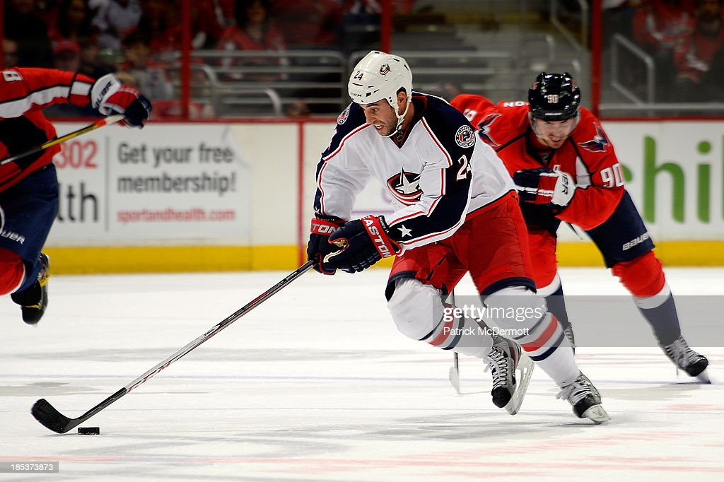 <a gi-track='captionPersonalityLinkClicked' href=/galleries/search?phrase=Derek+MacKenzie&family=editorial&specificpeople=685877 ng-click='$event.stopPropagation()'>Derek MacKenzie</a> #24 of the Columbus Blue Jackets brings the puck up ice during the third period of an NHL game against the Washington Capitals at Verizon Center on October 19, 2013 in Washington, DC.