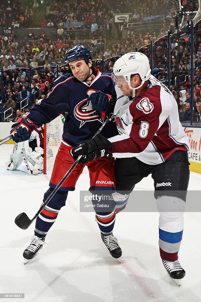 <a gi-track='captionPersonalityLinkClicked' href=/galleries/search?phrase=Derek+MacKenzie&family=editorial&specificpeople=685877 ng-click='$event.stopPropagation()'>Derek MacKenzie</a> #24 of the Columbus Blue Jackets collides with <a gi-track='captionPersonalityLinkClicked' href=/galleries/search?phrase=Jan+Hejda&family=editorial&specificpeople=624333 ng-click='$event.stopPropagation()'>Jan Hejda</a> #8 of the Colorado Avalanche during the third period on April 1, 2014 at Nationwide Arena in Columbus, Ohio. Colorado defeated Columbus 3-2 in overtime.