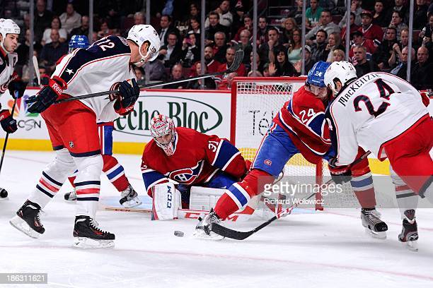 Derek MacKenzie of the Columbus Blue Jackets shoots the puck on Carey Price of the Montreal Canadiens during the NHL game at the Bell Centre on...