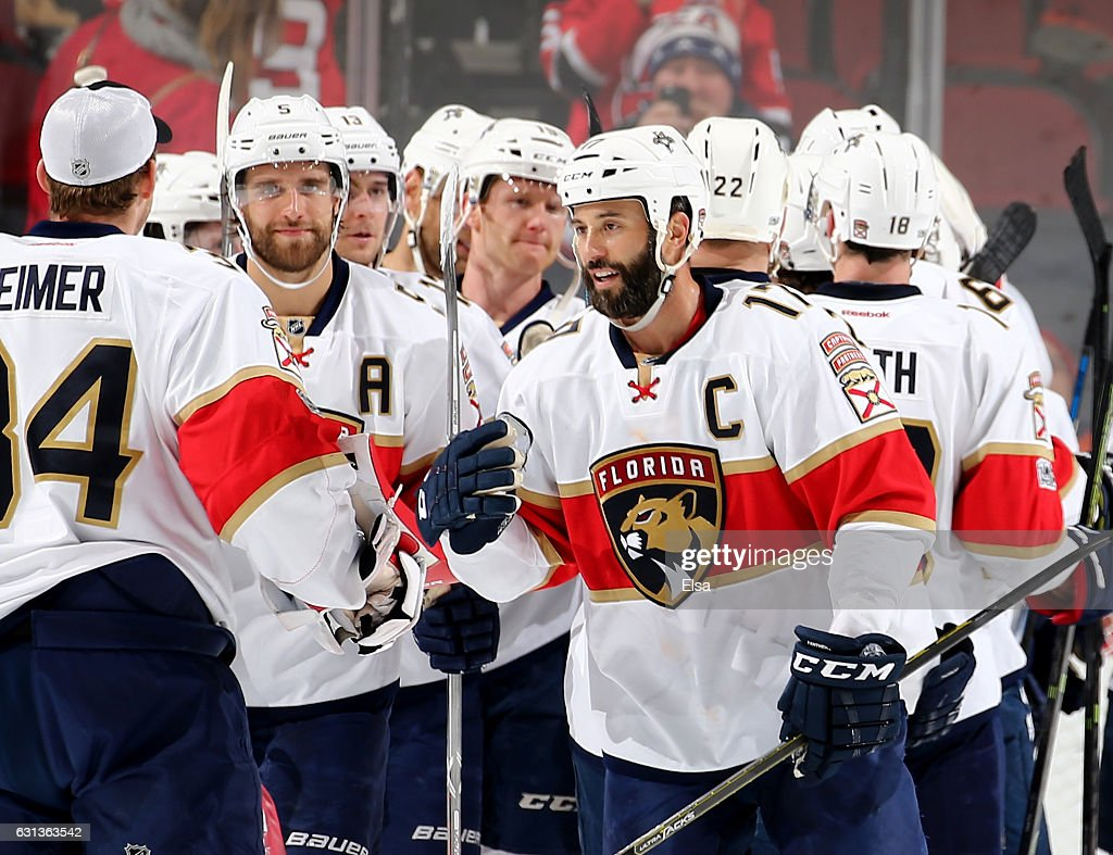 ... Derek MacKenzie 17 of the Florida Panthers and the rest of the team  celebrates the ... 3da77d17f
