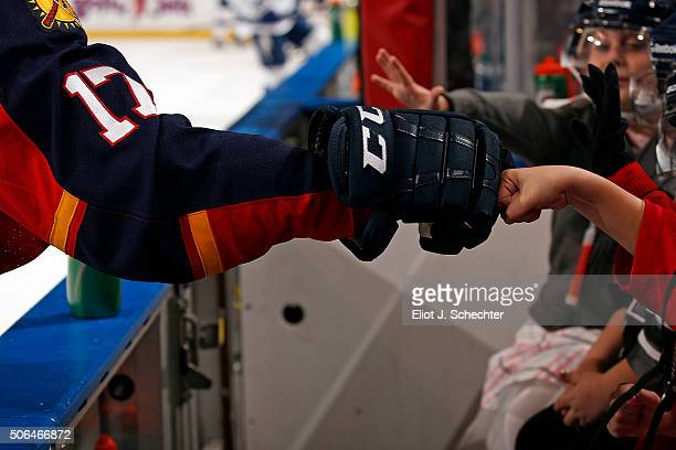 Derek MacKenzie of the Florida Panthers knuckle bumps young benchwarmers prior to the start of the game against the Tampa Bay Lightning at the BBT...