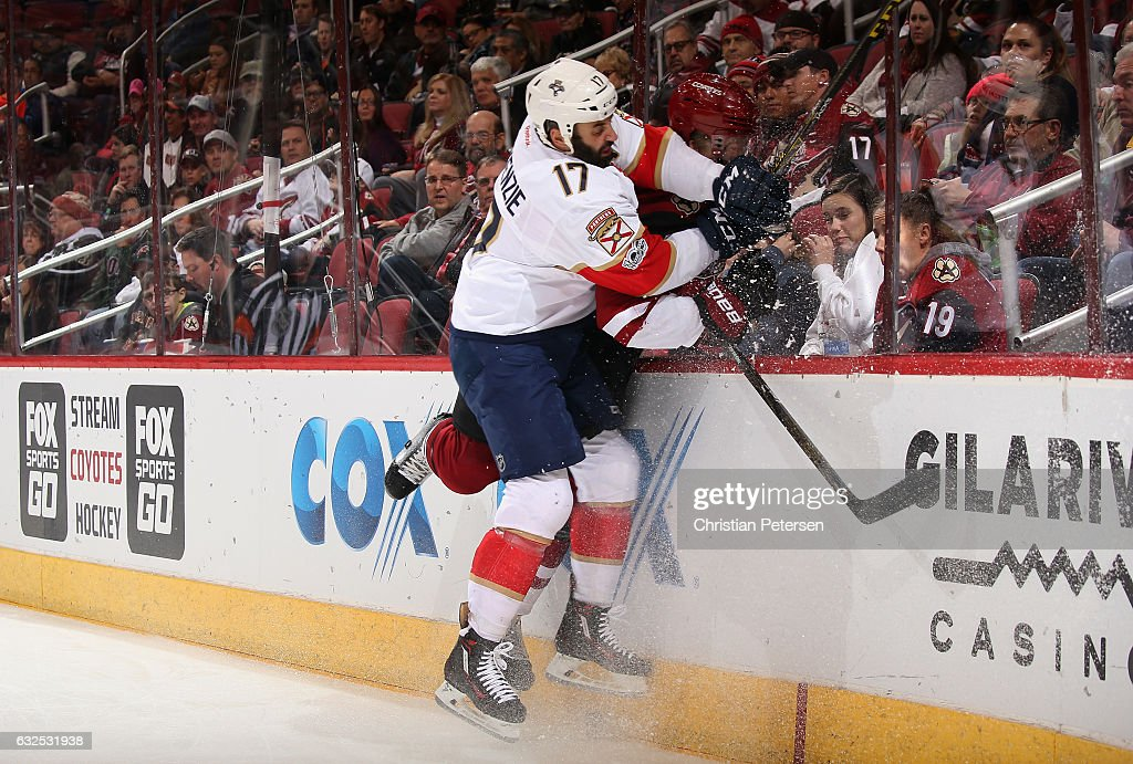 Derek MacKenzie #17 of the Florida Panthers lays a body check onto Connor Murphy #5 of the Arizona Coyotes during the first period of the NHL game at Gila River Arena on January 23, 2017 in Glendale, Arizona.