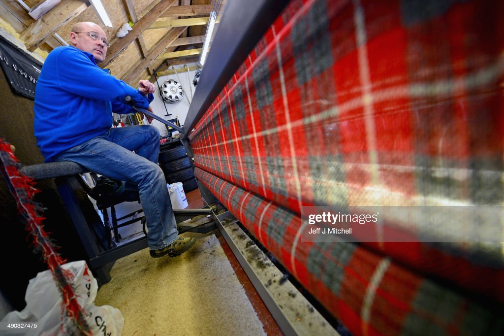 Derek Macleod from Kirkvick weaves in his shed on May 13,2014 in Lewis, Scotland. Sales in one of Scotlands last cottage industries are soaring with Japan, Russia and Germany being some of the largest international importers of the cloth.