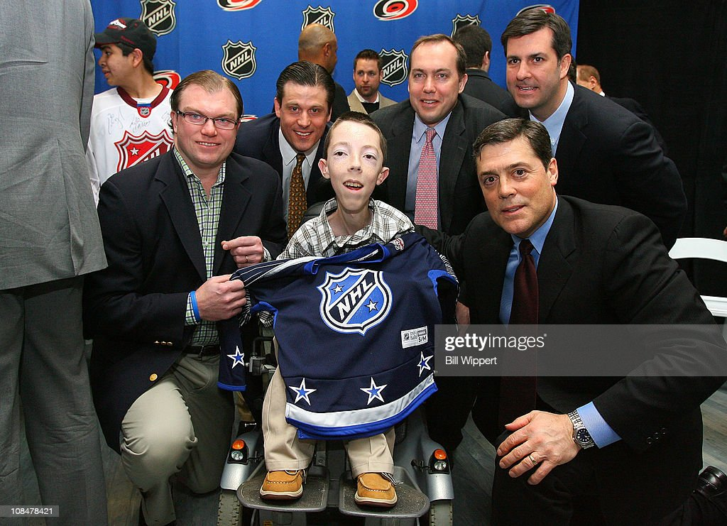 Derek MaGuire, Mike Pendy, Peter Ramsey, James Olsen and Pat LaFontaine, President of Companions in Courage, pose for a photo with 16-year old Jonathan Crighton during the Lion's Den 'Champions in Courage' North Carolina Chidren's Hospital Chapel Hill visit as part of 2011 NHL All-Star Weekend on January 28, 2011 in Raleigh, North Carolina.