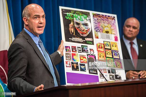 Derek Maltz special agent in charge at the Drug Enforcement Agency holds a poster showing common synthetic drugs at a news conference at DEA...