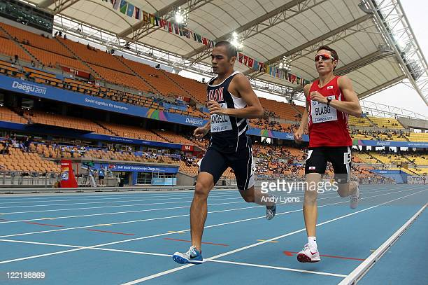 Derek Mandell of Guam and Richard Blagg of Gibraltar compete in the men's 800 metres heats during day one of the 13th IAAF World Athletics...