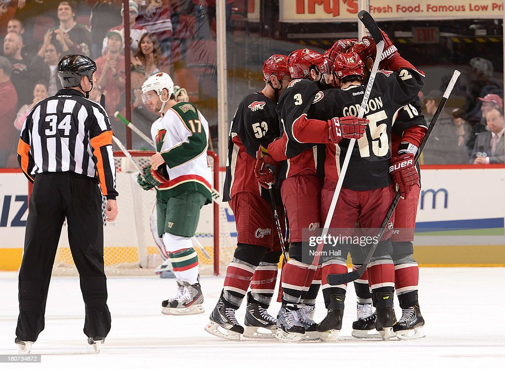 Derek Morris #53, Keith Yandle #3 and Boyd Gordon#15 of the Phoenix Coyotes celebrate with Lauri Korpikoski #28 after his first period goal against the Minnesota Wild at Jobing.com Arena on February 4, 2013 in Glendale, Arizona.