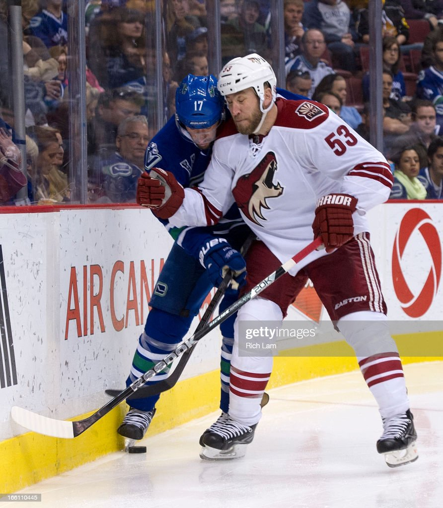 <a gi-track='captionPersonalityLinkClicked' href=/galleries/search?phrase=Derek+Morris&family=editorial&specificpeople=204188 ng-click='$event.stopPropagation()'>Derek Morris</a> #53 of the Phoenix Coyotes hits <a gi-track='captionPersonalityLinkClicked' href=/galleries/search?phrase=Ryan+Kesler&family=editorial&specificpeople=206915 ng-click='$event.stopPropagation()'>Ryan Kesler</a> #17 of the Vancouver Canucks during the third period in NHL action on April 08, 2013 at Rogers Arena in Vancouver, British Columbia, Canada.