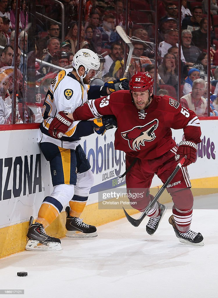<a gi-track='captionPersonalityLinkClicked' href=/galleries/search?phrase=Derek+Morris&family=editorial&specificpeople=204188 ng-click='$event.stopPropagation()'>Derek Morris</a> #53 of the Phoenix Coyotes skates after the puck ahead of <a gi-track='captionPersonalityLinkClicked' href=/galleries/search?phrase=Viktor+Stalberg&family=editorial&specificpeople=5802237 ng-click='$event.stopPropagation()'>Viktor Stalberg</a> #25 of the Nashville Predators during the NHL game at Jobing.com Arena on October 31, 2013 in Glendale, Arizona. The Coyotes defeated the Predators 5-4 in an overtime shoot out.