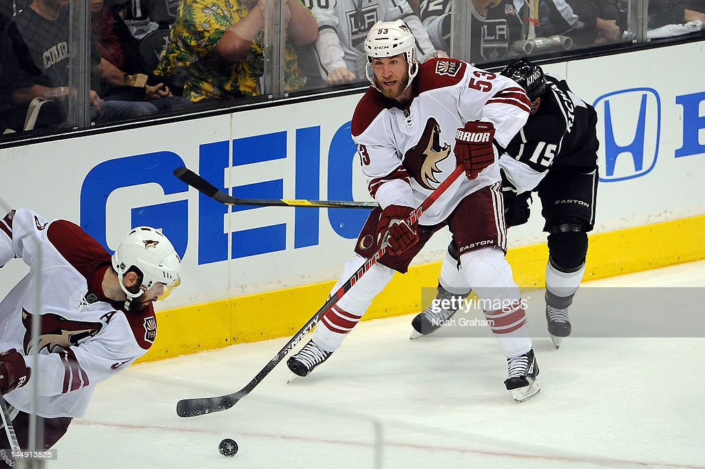<a gi-track='captionPersonalityLinkClicked' href=/galleries/search?phrase=Derek+Morris&family=editorial&specificpeople=204188 ng-click='$event.stopPropagation()'>Derek Morris</a> #53 of the Phoenix Coyotes skates with the puck against <a gi-track='captionPersonalityLinkClicked' href=/galleries/search?phrase=Brad+Richardson&family=editorial&specificpeople=638058 ng-click='$event.stopPropagation()'>Brad Richardson</a> #15 of the Los Angeles Kings in Game Four of the Western Conference Finals during the 2012 NHL Stanley Cup Playoffs at Staples Center on May 20, 2012 in Los Angeles, California.