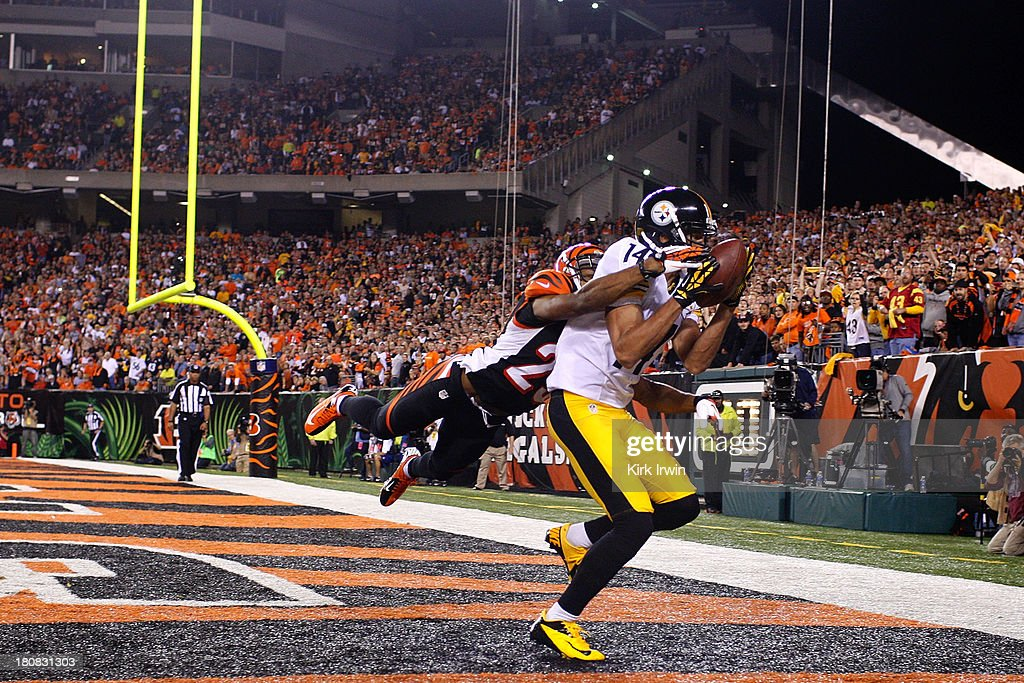 Derek Moye #14 of the Pittsburgh Steelers catches a pass for a touchdown over <a gi-track='captionPersonalityLinkClicked' href=/galleries/search?phrase=Leon+Hall&family=editorial&specificpeople=223989 ng-click='$event.stopPropagation()'>Leon Hall</a> #29 of the Cincinnati Bengals during the second quarter on September 16, 2013 at Paul Brown Stadium on September 16, 2013 in Cincinnati, Ohio.