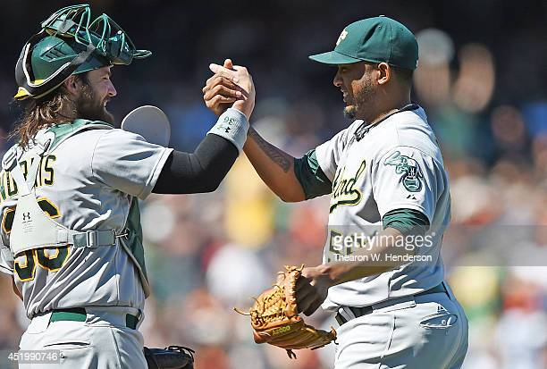 Derek Norris and Fernando Abad of the Oakand Athletics celebrates defeating the San Francisco Giants 61 at ATT Park on July 10 2014 in San Francisco...