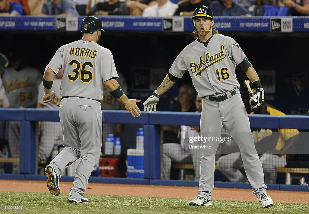 Derek Norris #36 and <a gi-track='captionPersonalityLinkClicked' href=/galleries/search?phrase=Josh+Reddick&family=editorial&specificpeople=5746348 ng-click='$event.stopPropagation()'>Josh Reddick</a> #16 of the Oakland Athletics celebrate a second inning run during MLB game action against the Toronto Blue Jays July 25, 2012 at Rogers Centre in Toronto, Ontario, Canada.