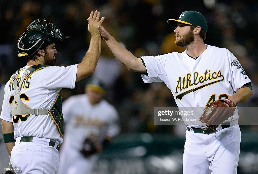 <a gi-track='captionPersonalityLinkClicked' href=/galleries/search?phrase=Derek+Norris&family=editorial&specificpeople=6795804 ng-click='$event.stopPropagation()'>Derek Norris</a> #36 and Ryan Cook #48 of the Oakland Athletics celebrates defeating the Texas Rangers 5-1 at O.co Coliseum on May 13, 2013 in Oakland, California.